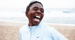 Evelina Tshabalala laughing on beach 2009-005570 copy_2