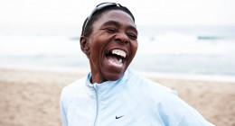 Evelina Tshabalala laughing on beach 2009-005570 copy_2